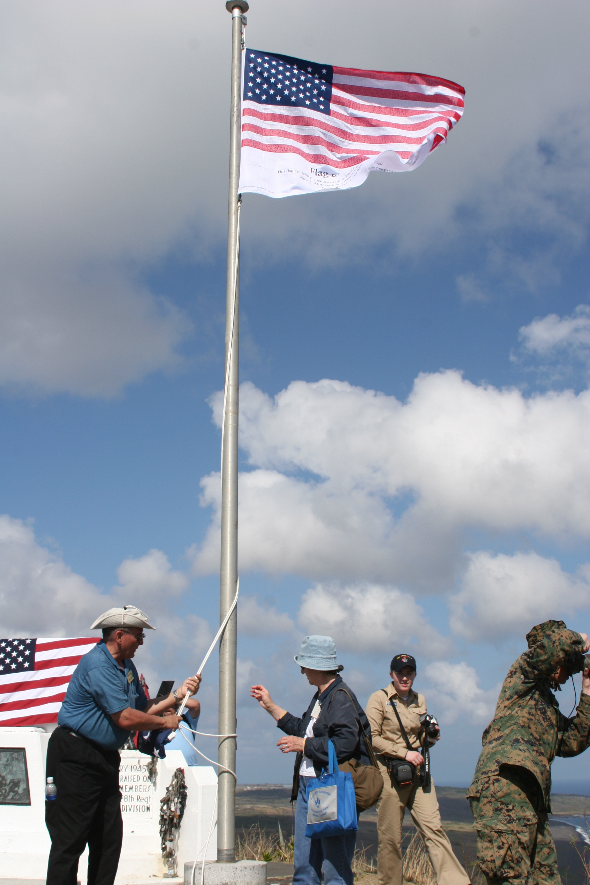 Guests raising flag on Iwo Jima