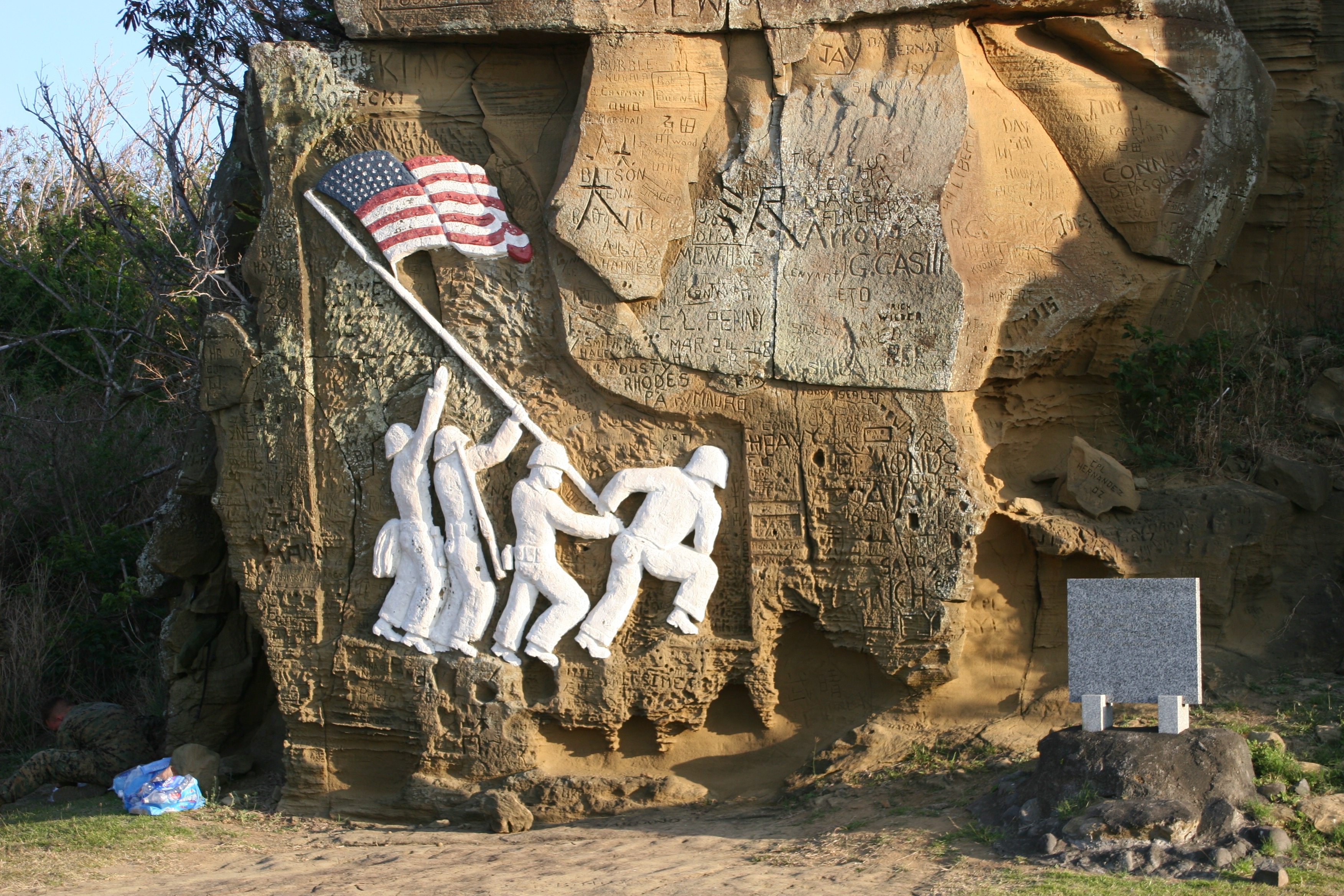 Replica of Iwo Jima flag raising etched on rock