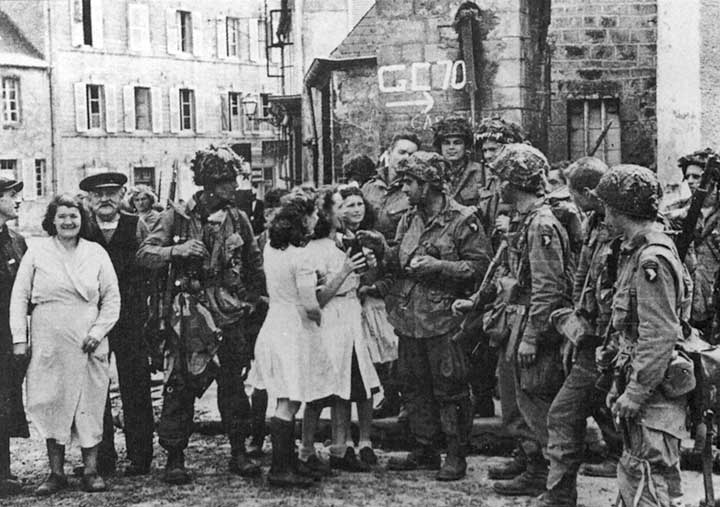 101st Airborne in St. Marie du Morte with girls