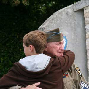 WWII veteran holding a child