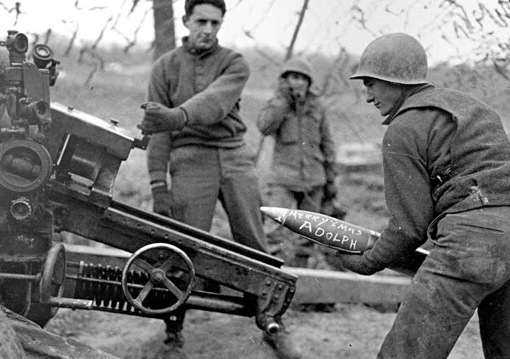 WWII soldier loading artillery