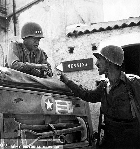 Patton in a tank talking to Lt. Col Lyle Bernard