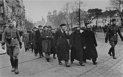 Nazi rounding up Jews in Warsaw WWII