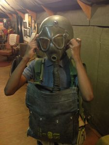 Student trying on D-Day gas mask