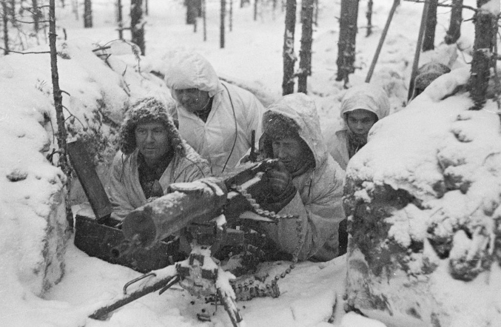 Finnish soldiers with machine gun during Winter War