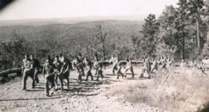 Paratroopers running up Currahee Mountain