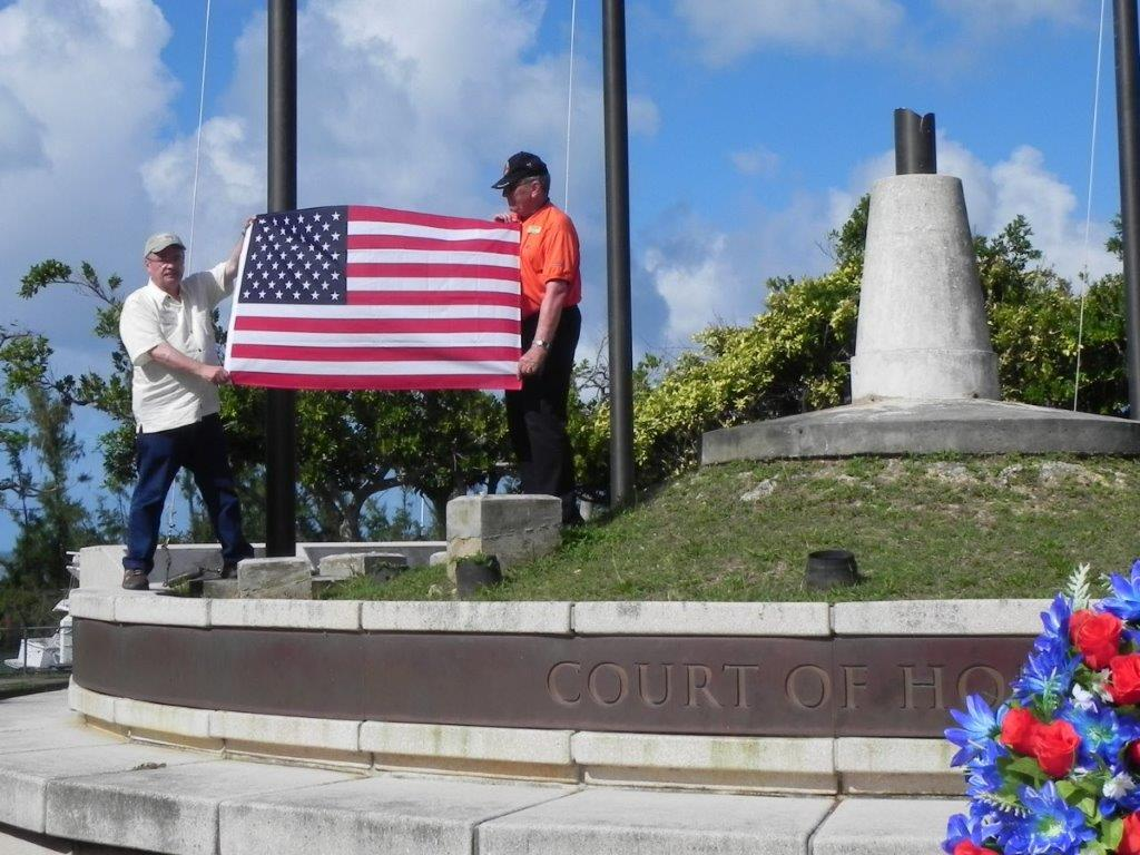 Raising American flag at American Memorial Park